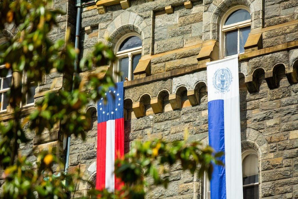 Healy Hall Graduation Ceremony Flags